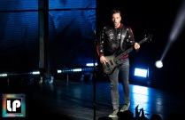 Chris Wolstenholme performs with Muse at Shoreline Amphitheater. Photo by Clay Lancaster.