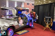Marty and Jennifer pose with the Back to the Future Delorean at Fan Expo Dallas