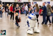 R2-D2 chases a little fan at Fan Expo Dallas